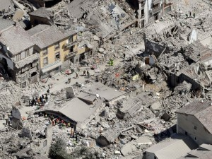 Rescuers search following an earthquake in Amatrice, Italy, Aug. 24, 2016.